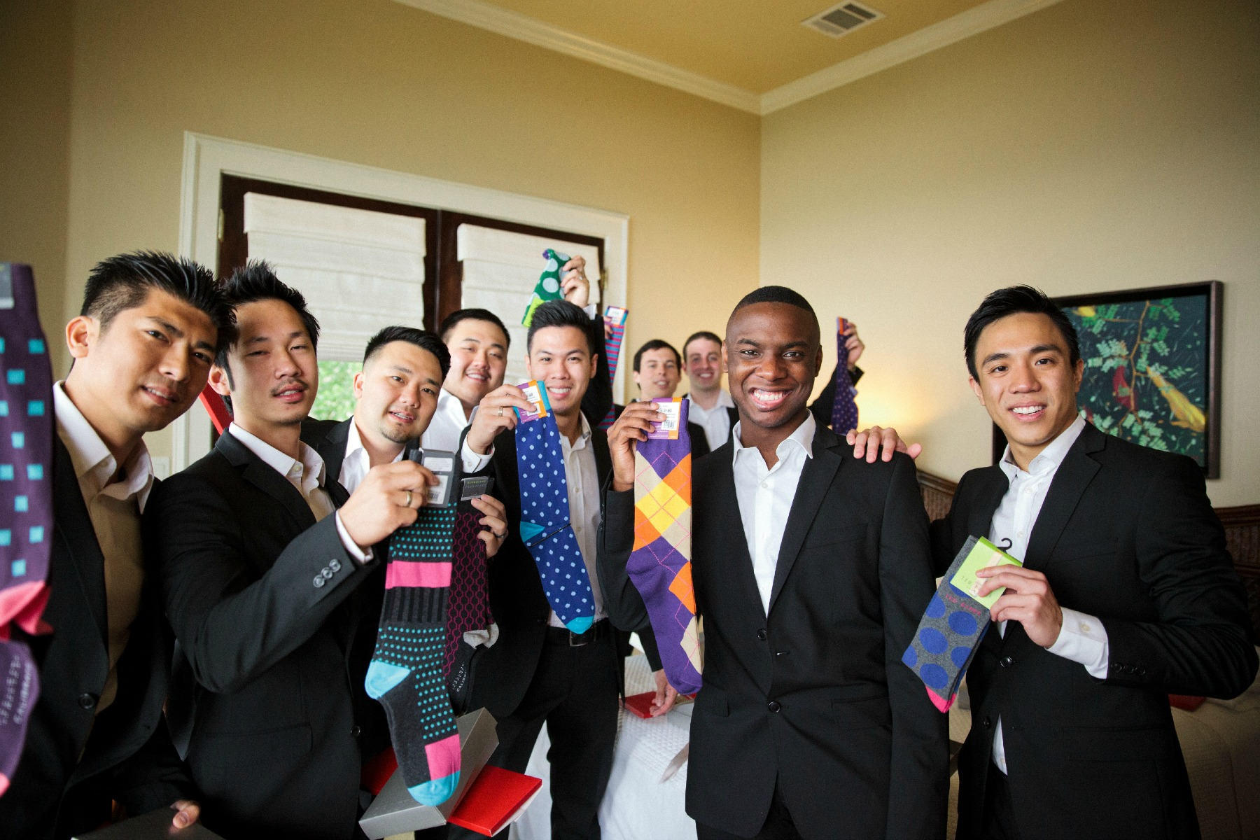 groomsmen showing off their printed socks