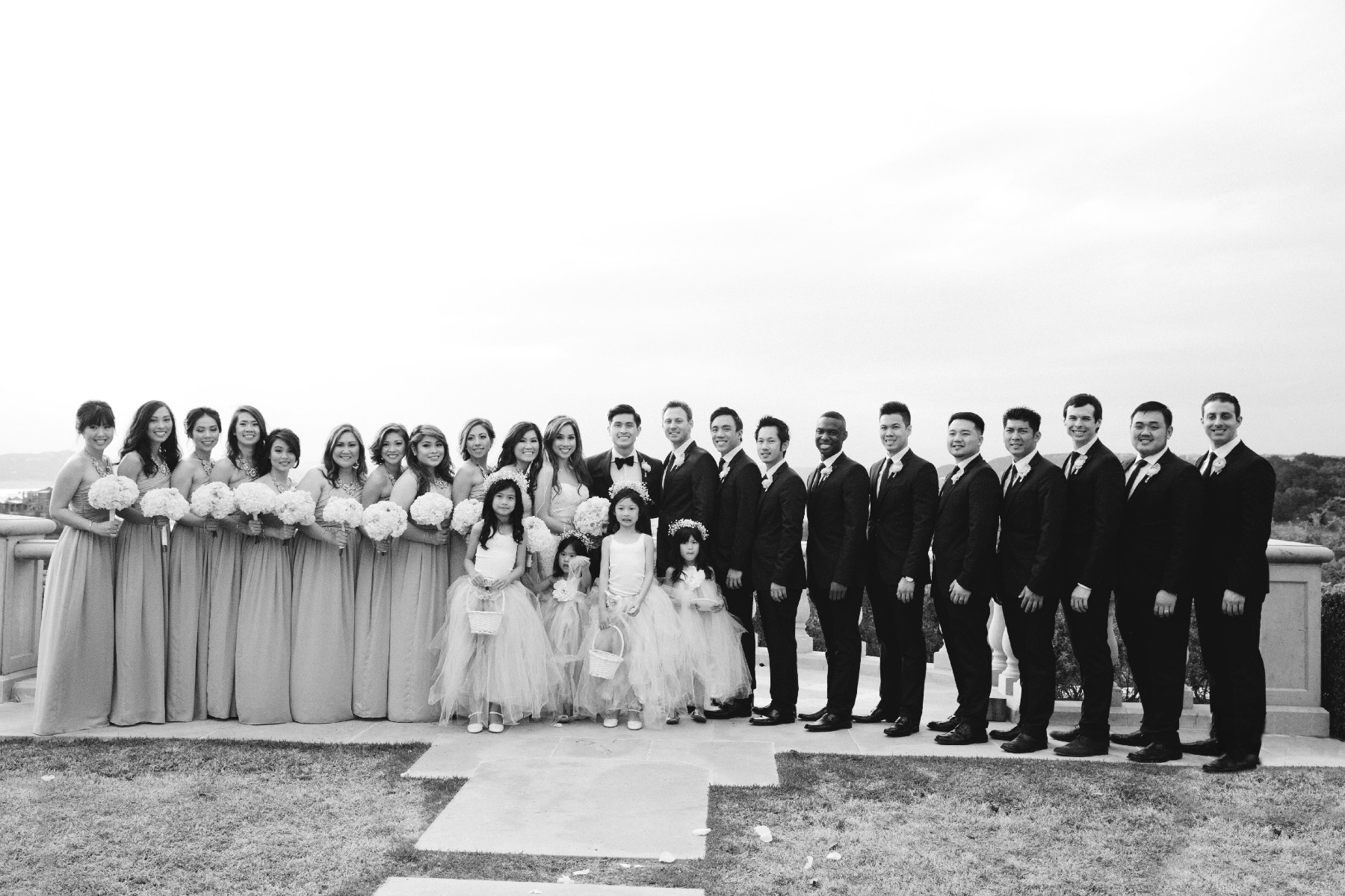 really big wedding party including the bridesmaids, wedding couple, flower girls and groomsmen