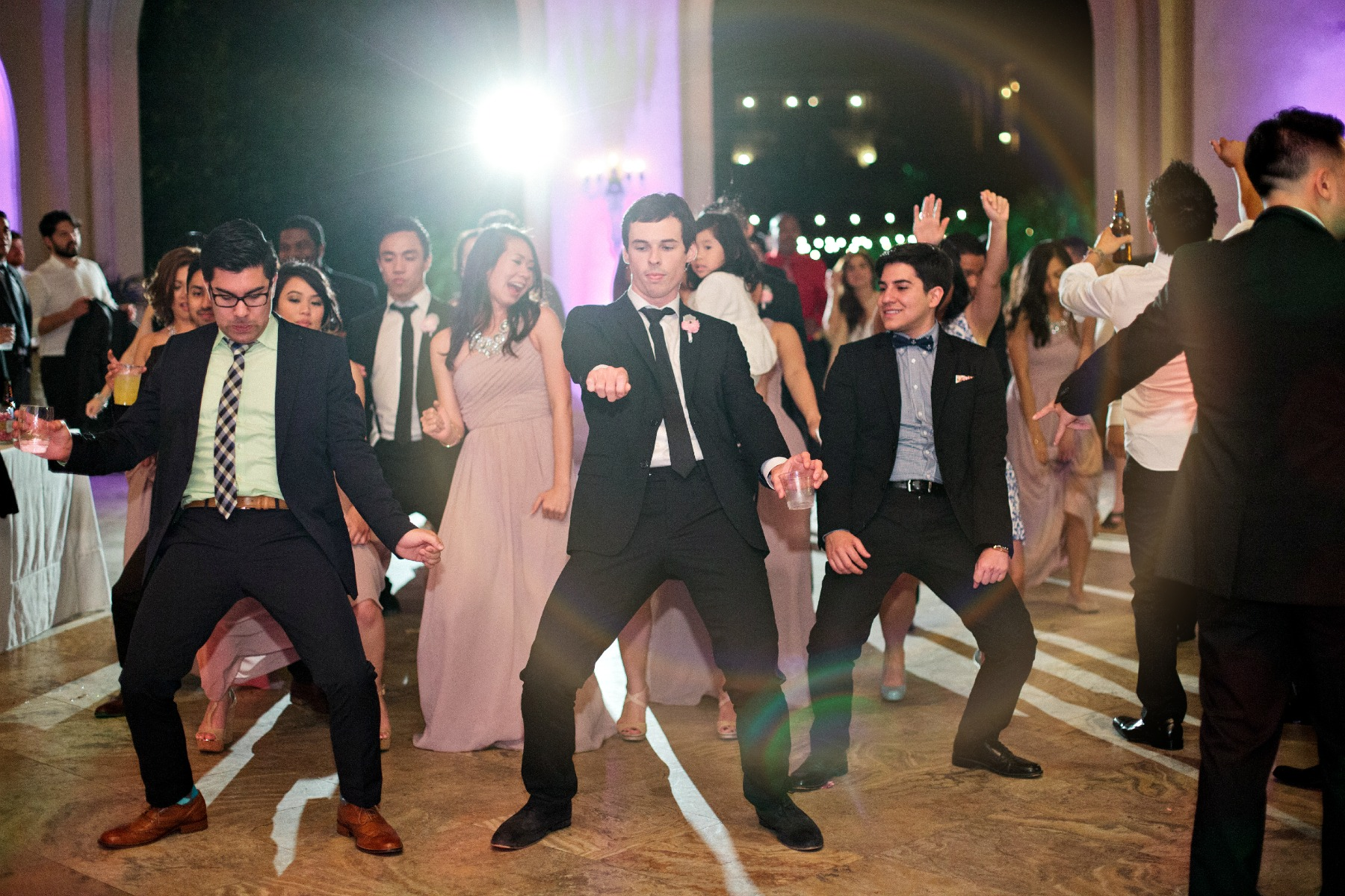 wedding guests dancing on the dance floor at a wedding