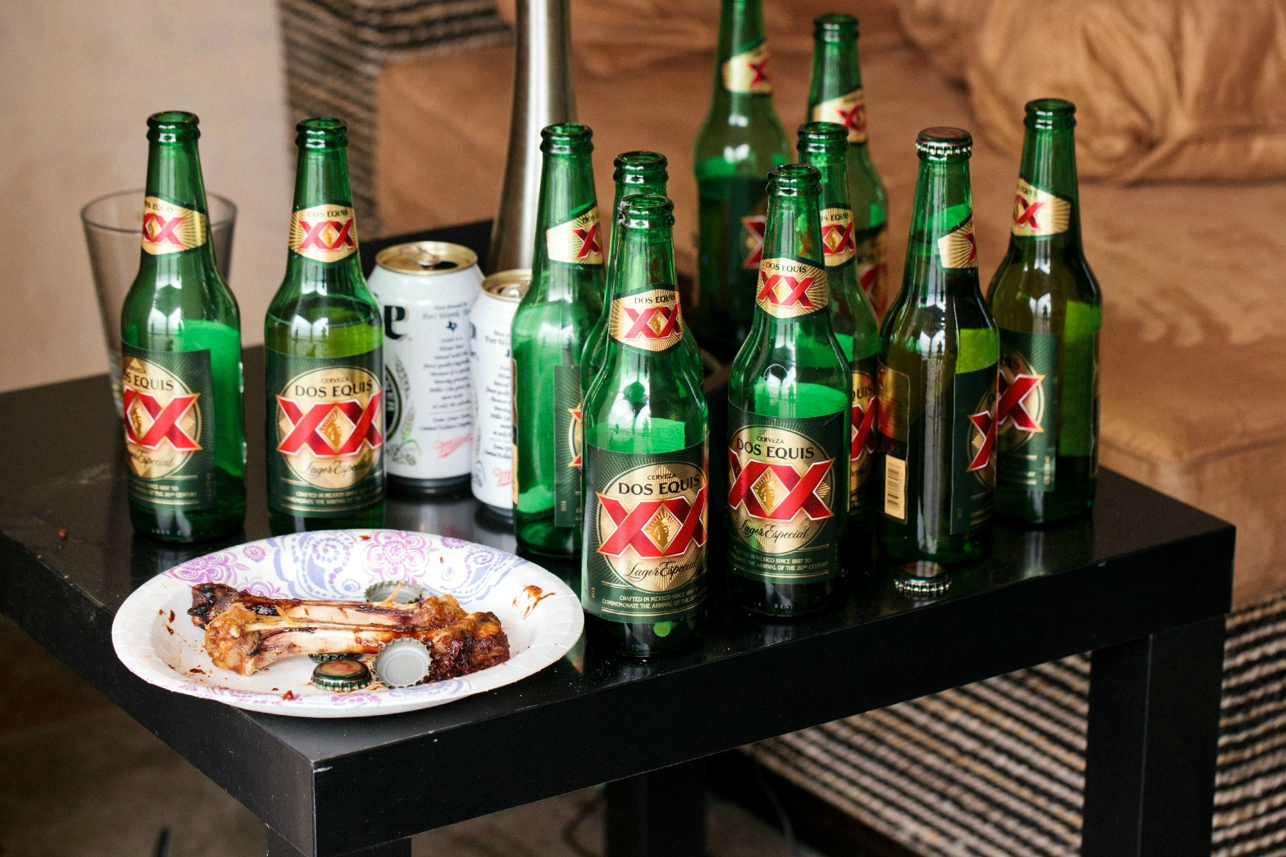 dos equis beer bottles leftover from the bachelor party