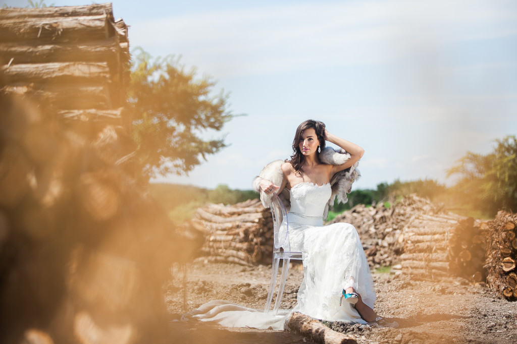 Bride in front of logs