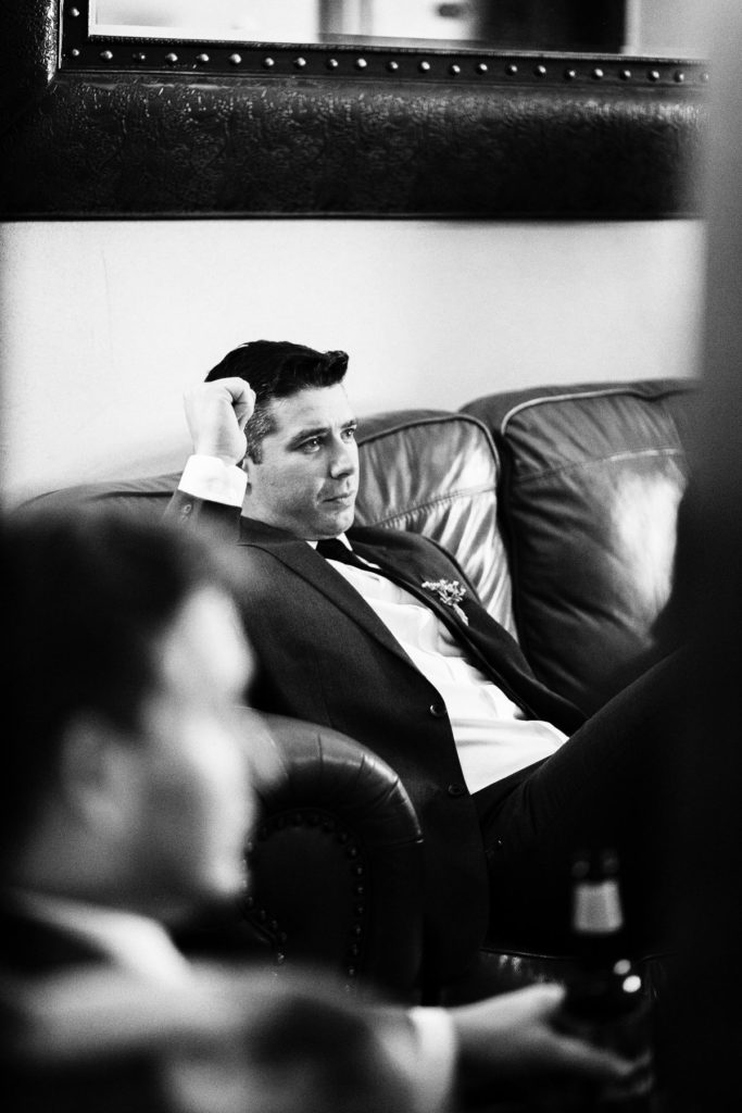 groom watching a game on tv