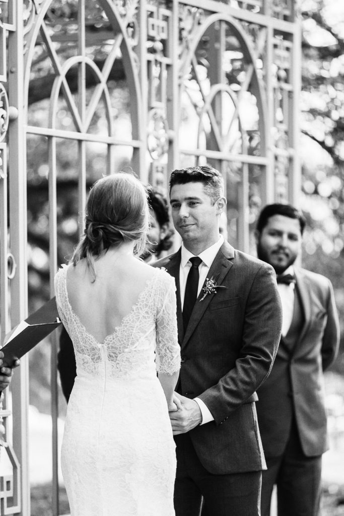 groom seeing his bride for the first time down the aisle