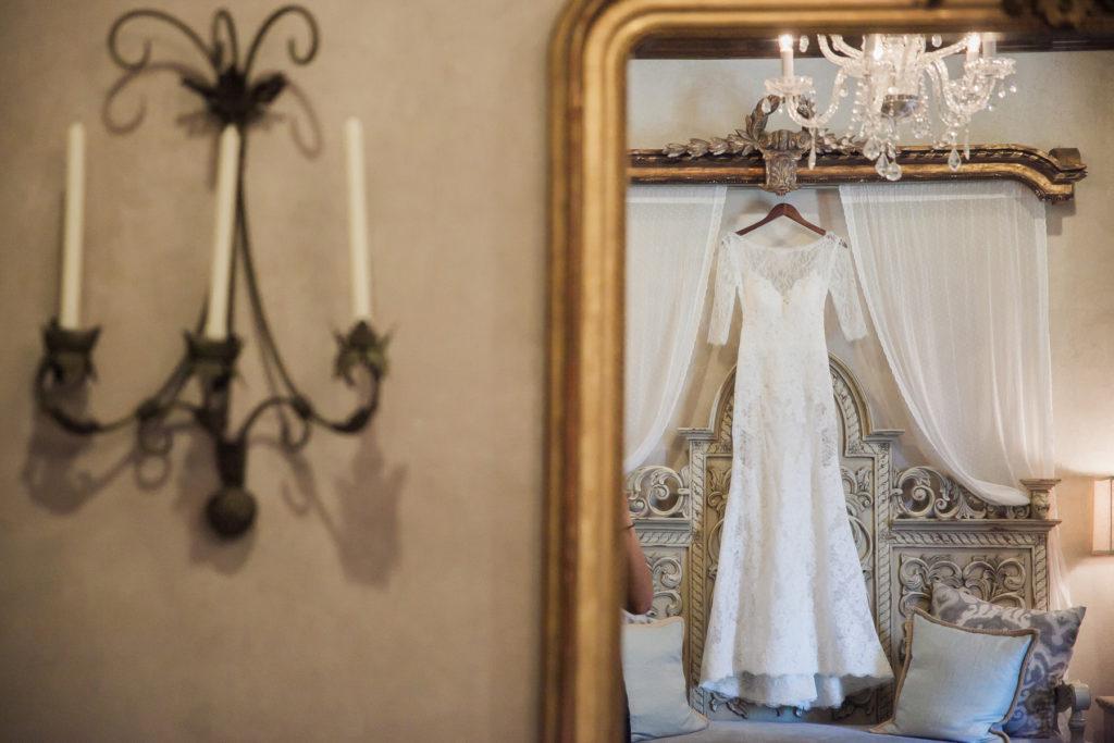 bride's wedding gown hanging